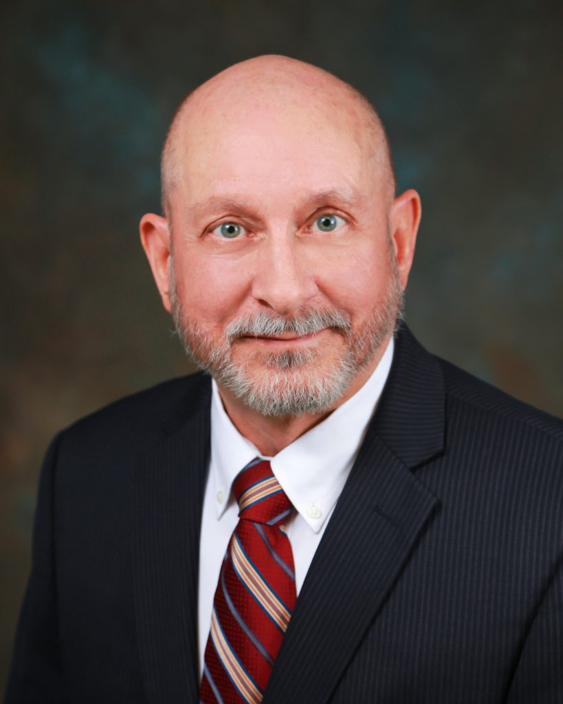 Wayne White specializes in Space law and government contracting
